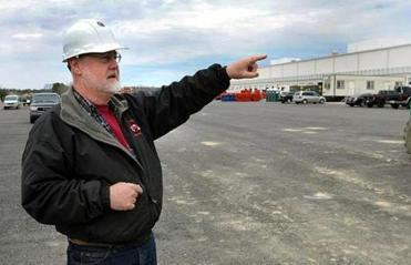 Plympton 3/24/2011- Ken Thompson, coordinator for Sysco Distribution Center, talks about the construction underway in the Plympton Industrial Park. Photo by Debee Tlumacki for the Boston Globe (regional) Reporter: Elaine Carroll